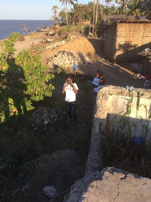 Students taking pictures and coordinate extraction of the ruins of the likely former navy prison , August 2019