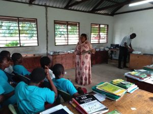 Woman teaching in school
