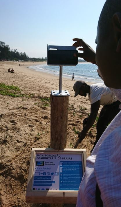 "Dr Nordino taking the first photo ""snap"" of the beach from the CoastSnap station in Ponta do Ouro (#coastsnapponta)"