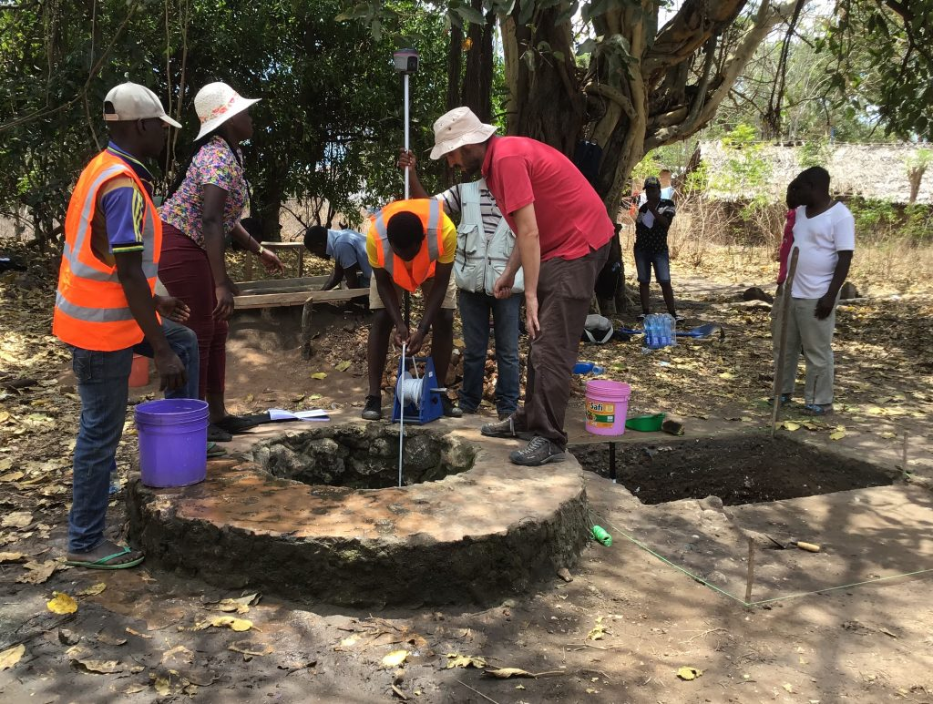 A team of archaeologists and geologists at one of the historic well in Kilwa Kisiwani