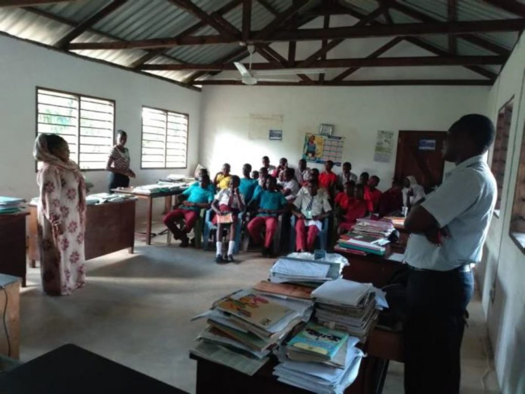 Madam Arfa Salim Baya presents on MUCH at Mida Secondary school which is located at Mida Creek (Field Data August, 2019)