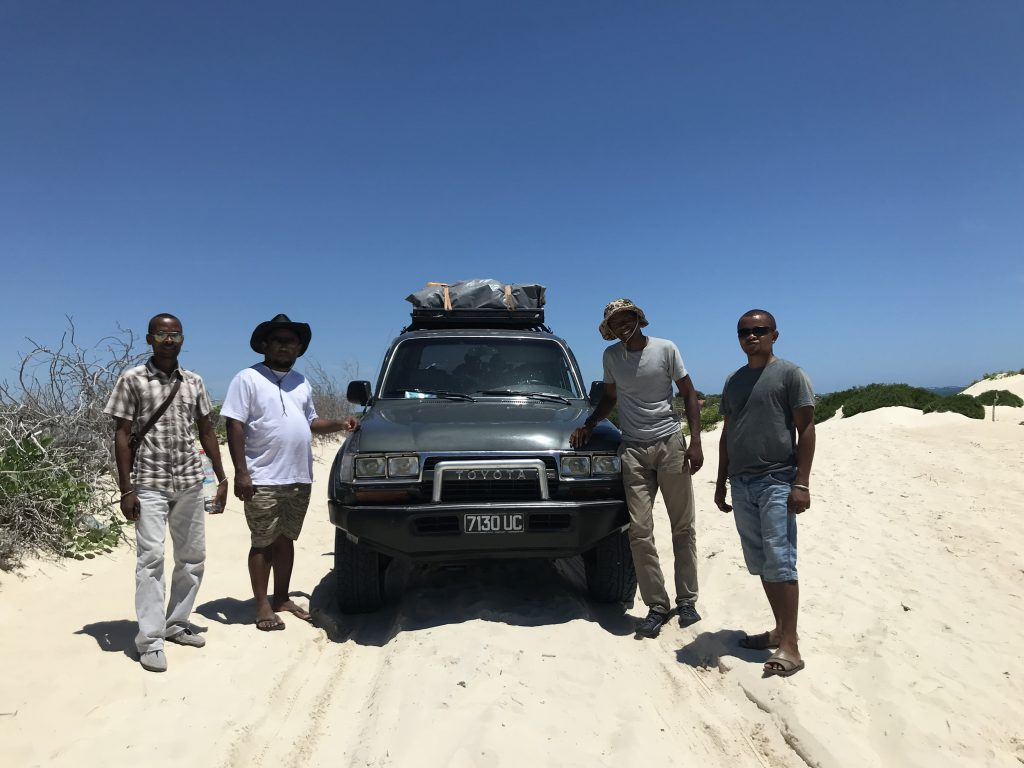 Project team stood by car