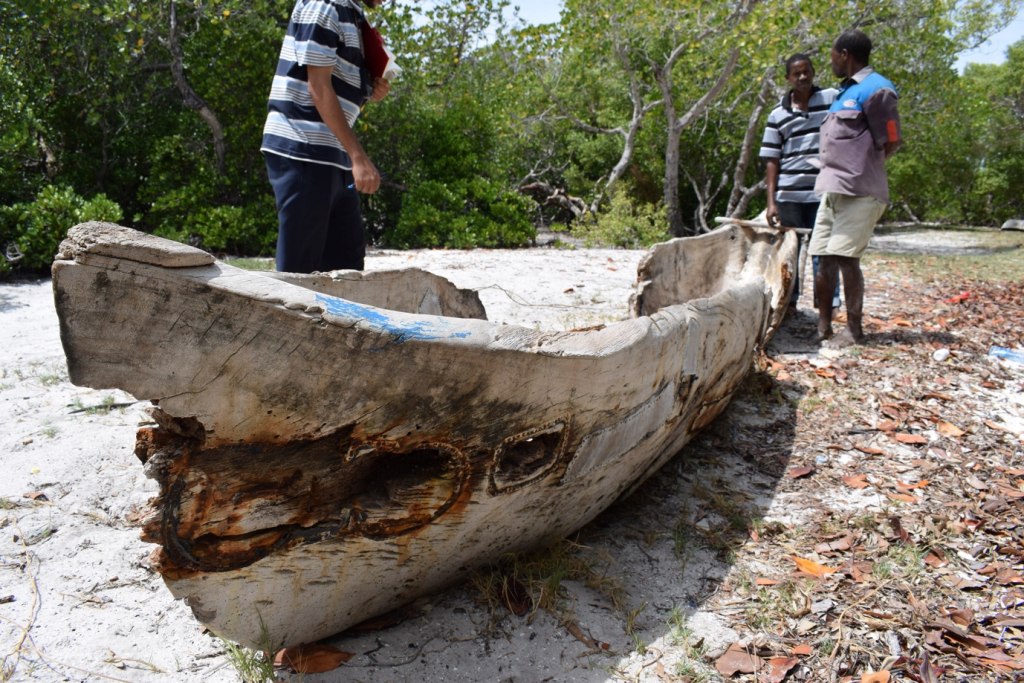 Image of men working on a boat, Boat Mapping Cover Image, Field Work 2019