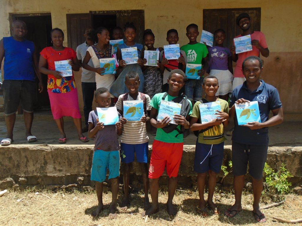 Sea Turtle Story Book Launch, children holding copies of the books
