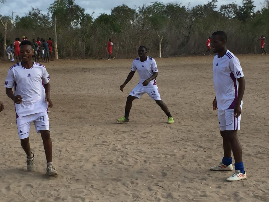 Participants playing football at Mgao sports day