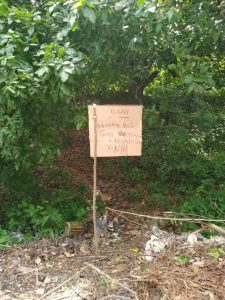 Warning sign in Kiswahili- along the fence of a neighbour. Translation 'No dumping of rubbish or harvesting of firewood'